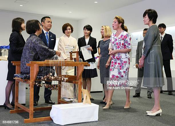 Malgorzata Tusk wife of European Council President Donald Tusk Akie Abe wife of Japanese Prime Minister Shinzo Abe and Sophie GregoireTrudeau wife of...