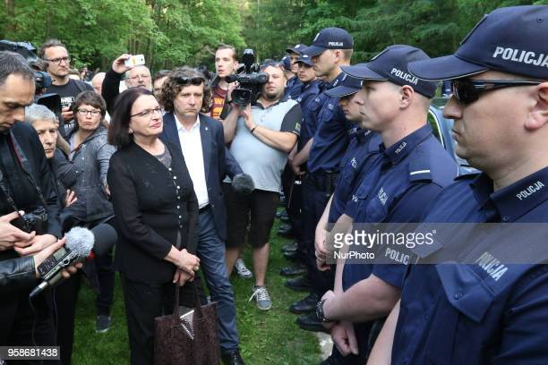 Malgorzta Rybicka trying to pass a police cordon is seen in Gdansk Poland at the Srebrzysko cemetery on 14 May 2018 The prosecutor's office against...