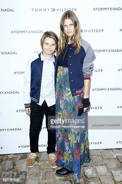 Malgosia Bela and her son Jozef Bela attend the Tommy Hilfiger Hosts Tommy X Nadal Party Photocall on May 18 2016 in Paris France
