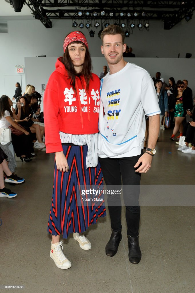 Malgosia Garnys (L) and violinist Filip Pogady attend the Semir X CJ Yao front Row during New York Fashion Week: The Shows at Gallery II at Spring Studios on September 12, 2018 in New York City.