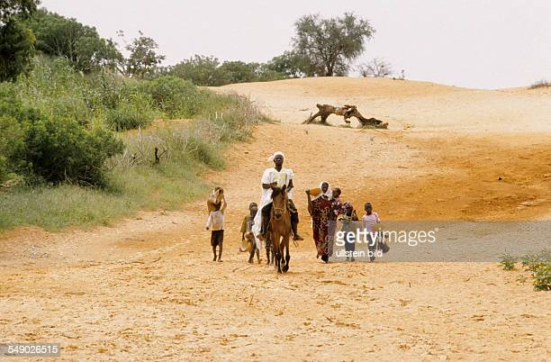 Marabout and his followers travelling through Dogon country on a missionary trip. -