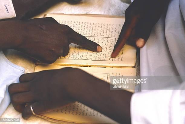 Marabout teaching the Koran in a Dogon village. -