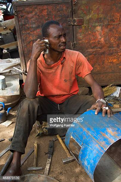 Mali Bamako Recycle Market Scrap Metal Worker On Cell Phone