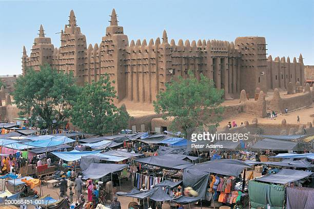 mali, djenne, mosque and market - peter adams stock pictures, royalty-free photos & images