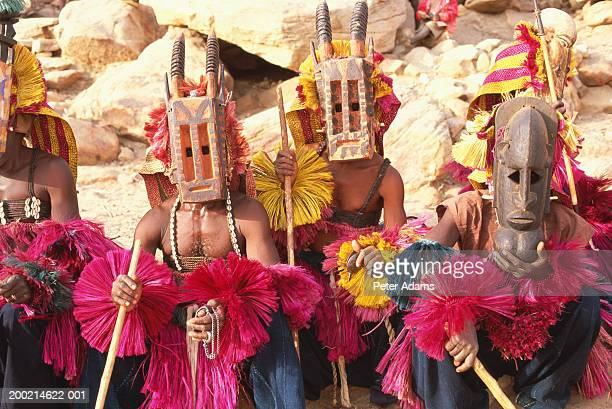 Mali, Dogon Country, men wearing ceremonial masks