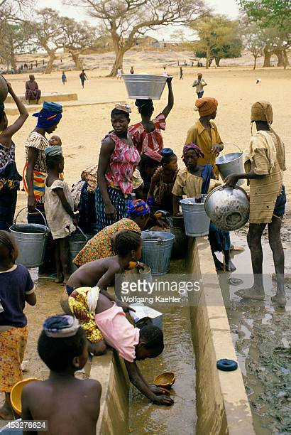 Mali Dogon Country Sanga Water Well With Local People Drawing Water