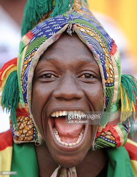 A Mali fan smiles during a 2nd round qualifing match of African Cup of Nations football championships CAN2010 between Algeria and Mali at November 11...