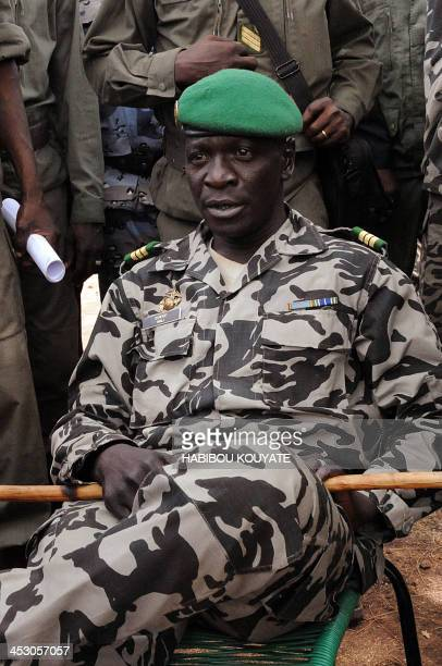 Mali junta leader Captain Amadou Sanogo poses surrounded by his fellow soldiers in Bamako on March 22 2012 Coup leaders in Mali Today ordered all...