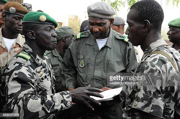 Mali junta leader Captain Amadou Sanogo speaks to his fellow soldiers at the Kati Military camp in a suburb of Bamako on March 22 2012 Coup leaders...