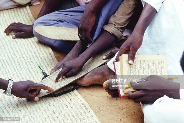 Marabout giving Koran lesson in a Dogon village