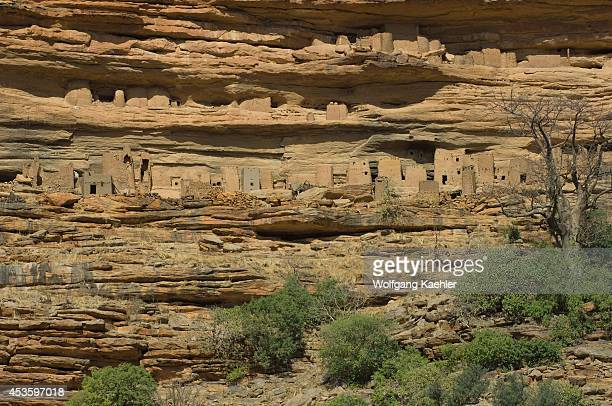 Mali Near Bandiagara Dogon Country Bandiagara Escarpment Banani Dogon Village Cliffside Dwellings Of Tellem Tribe Above Village