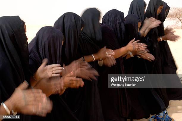 Mali Near Timbuktu Sahara Desert Tuareg Women Performing Traditional Dance In Desert Clapping With Hands Close Up