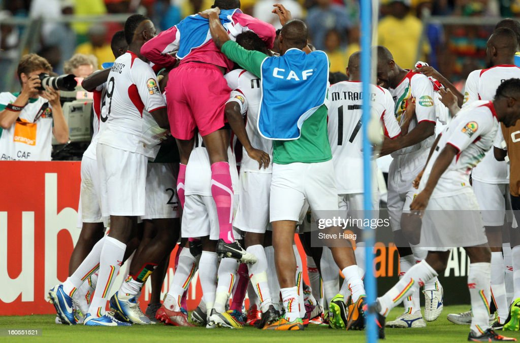 Mali players celebrate victory in the 2013 African Cup of Nations Quarter-Final match between South Africa and Mali at Moses Mahbida Stadium on February 02, 2013 in Durban, South Africa.