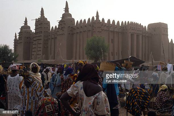 Mali Sahel Djenne Busy market scene with Grand Mosque behind