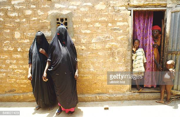 Veiled Wahabit women and a animistic woman in a Dogon village