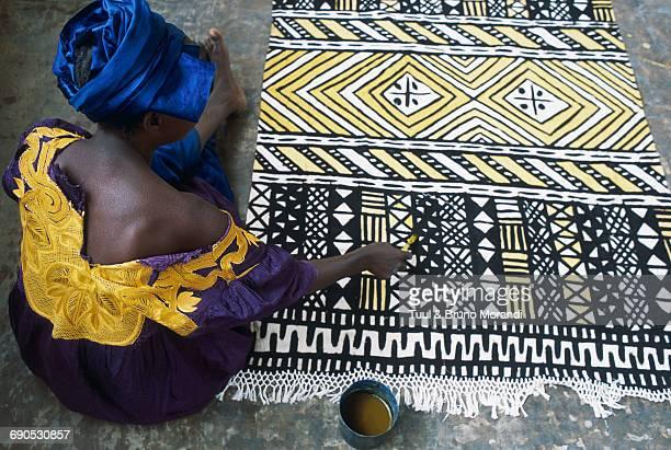 Mali, woman making Bogolan, coton carpet