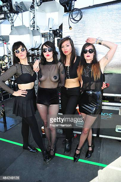 Malia James Dee Dee Penny Sandra Vu and Jules Medeiros of Dum Dum Girls backstage during day 1 of the 2014 Coachella Valley Music Arts Festival at...