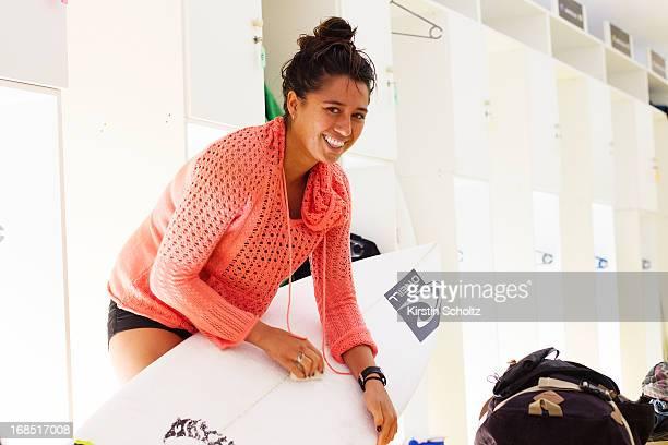 Malia Manuel of Hawaii waxes her surfboard on May 10 2013 in Rio de Janeiro Brazil