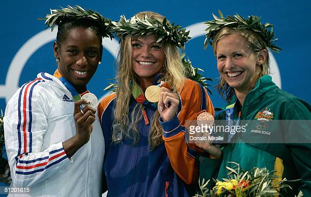 Malia Metella of France wins the silver medal Inge de Bruijn of the Netherlands wins the gold medal and Lisbeth Lenton of Australia wins the bronze...