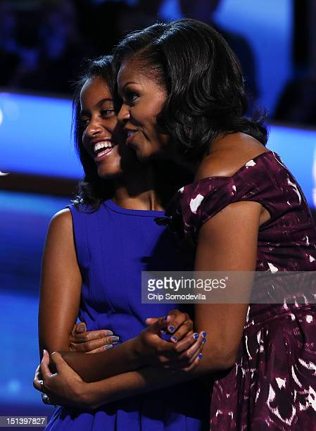 Malia Obama and First lady Michelle Obama stand on stage after Democratic presidential candidate US President Barack Obama accepted the nomination...