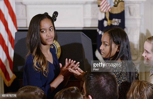Malia Obama and Sasha Obama look on durinng a ceremony presenting the Medal of Freedom to VicePresident Joe Biden at the State Dining room of the...