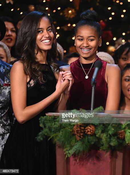 Malia Obama and Sasha Obama speak onstage at TNT Christmas in Washington 2014 at the National Building Museum on December 14 2014 in Washington DC...