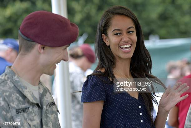 Malia Obama, daughter of US President, smiles as she serves food during a lunch at the United States and Nato military base in Vicenza on June 19,...