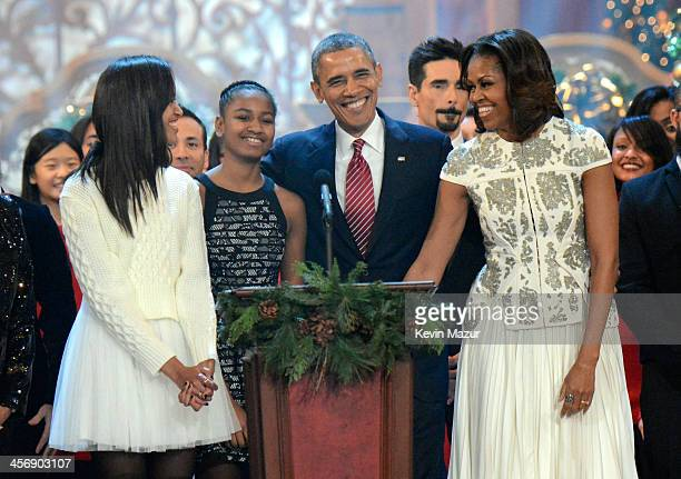 Malia Obama Sasha Obama US President Barack Obama and First Lady Michelle Obama onstage at TNT Christmas in Washington 2013 at the National Building...
