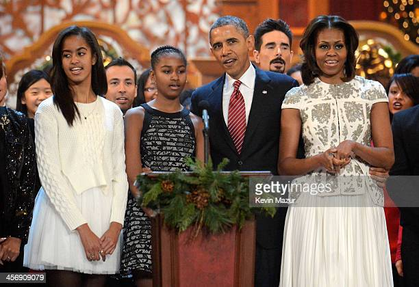 Malia Obama Sasha Obama US President Barack Obama and First Lady Michelle Obama speak onstage at TNT Christmas in Washington 2013 at the National...