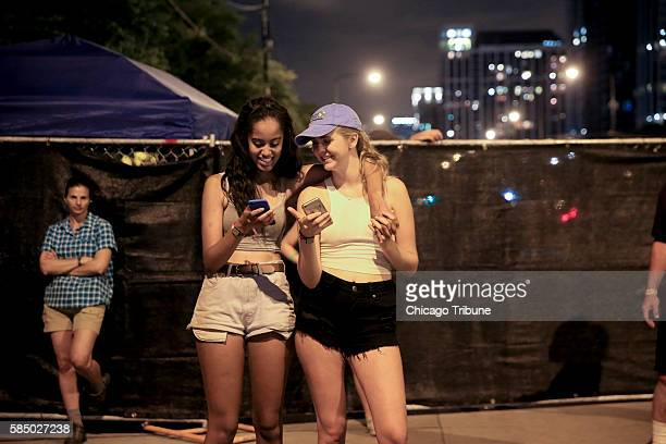 Malia Obama talks with a friend during day three of Lollapalooza in Grant Park Saturday July 30 in Chicago
