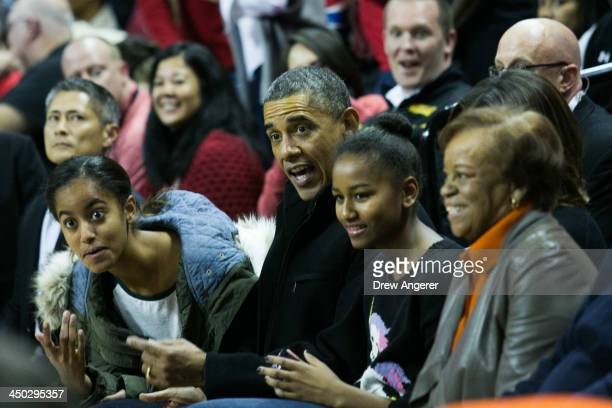 Malia Obama, U. S. President Barack Obama, Sasha Obama and Marian Robinson attend a men's NCCA basketball game between University of Maryland and...