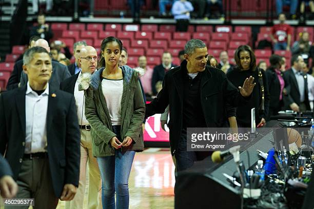 Malia Obama, U.S. President Barack Obama and first lady Michelle Obama arrive at a men's NCCA basketball game between University of Maryland and...