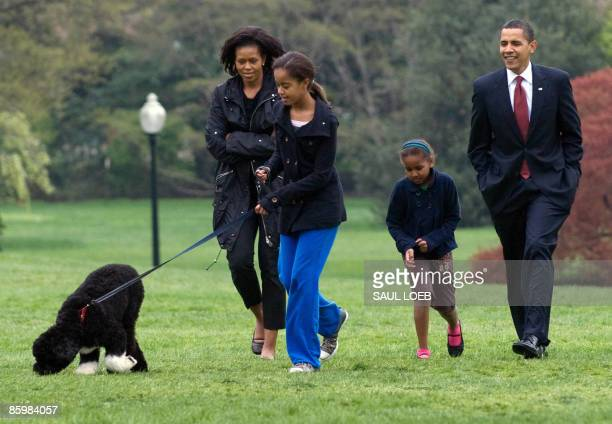Malia Obama walks her new sixmonth old Portuguese water dog Bo alongside US President Barack Obama Sasha Obama and First Lady Michelle Obama on the...