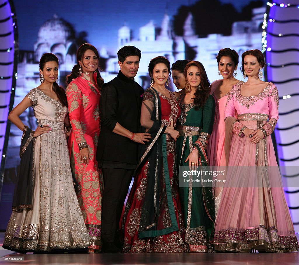 Maliaka Arora Khan Lara Dutta Madhuri Dixit Prety Zinta and Isha Koppikar wear designs by Indian designer Manish Malhotra during a fashion show to...