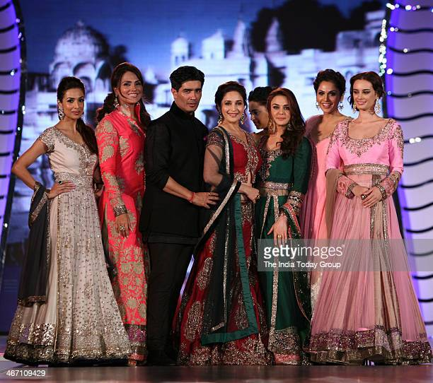 Maliaka Arora Khan Lara Dutta Madhuri Dixit Prety Zinta and Isha Koppikar wear designs by Indian designer Manish Malhotra during a fashion show to...