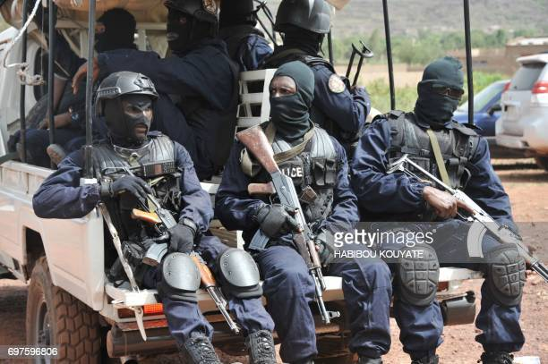 Malian antiterrorist special forces 'Forsat' members arrive at the entrance of the Kangaba tourist resort in Bamako on June 19 a day after suspected...
