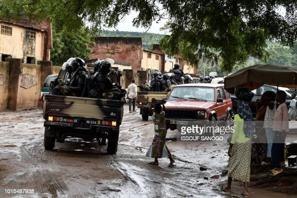 Malian antitiot police officers patrol in the streets of Bamako on August 12 2018 during the second round of Mali's presidential election