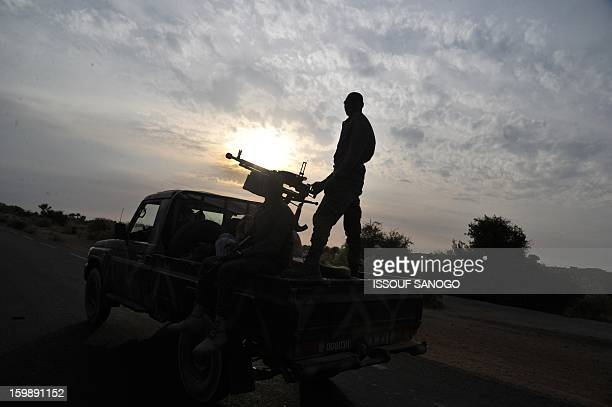 A Malian army armed pickup truck drives near Markala on on January 22 2013 Italy said Tuesday it will send three planes to Mali to help support...