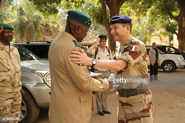Malian Army CHief of Staff General Mahamane Toure greets French Army Chief of Staff General Pierre de Villiers upon his arrival for their meeting at...