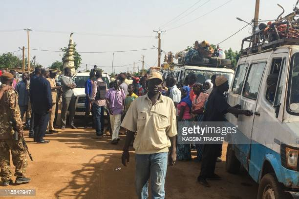 Malian displaced people gather on July 29 2019 in Koro close to the border with Burkina Faso as they prepare to return to their villages as some 600...