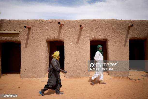 Malian faithfuls walk in the courtyard of the Tomb of Askia in Gao on March 10, 2020. - The site, which was protected during the 10 months of...