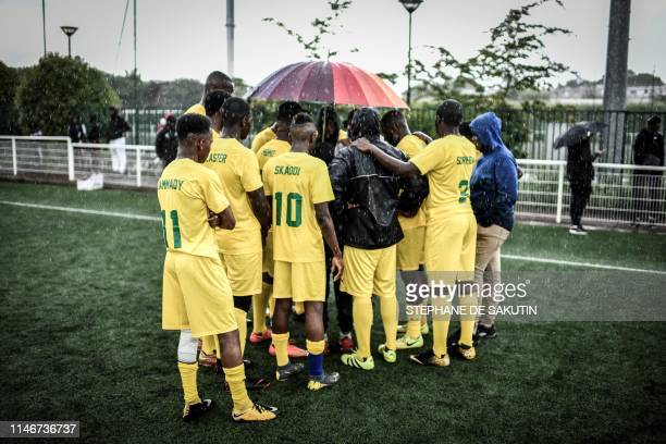 """Malian football players attend a briefing prior a match between 'Mali' and 'the rest of the world' teams as part of the """"CAN Epinetzo"""", an amateur..."""