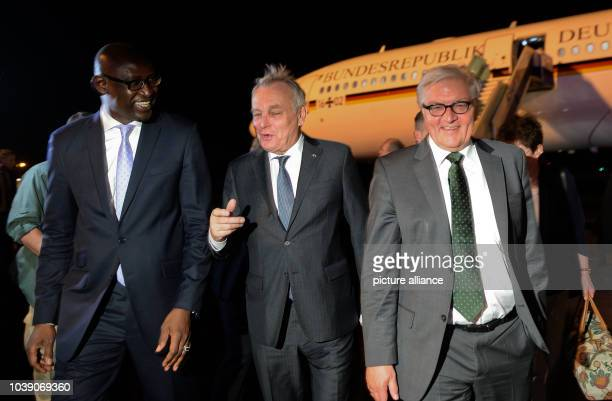 Malian foreign minister Abdoulaye Diop welcomes his French counterpart JeanMarc Ayrault and German foreign ministerFrankWalter Steinmeier at the...