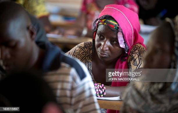 Malian girls and boys attend class at the Lycee Yana Maiga in Gao on March 11, 2013. The school director told girls and boys that they were not...