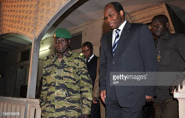 Malian junta leader captain Amadou Sanogo and Burkina Faso's Foreign Minister Djibril Bassole after a meeting at the Kati military camp near Bamako...