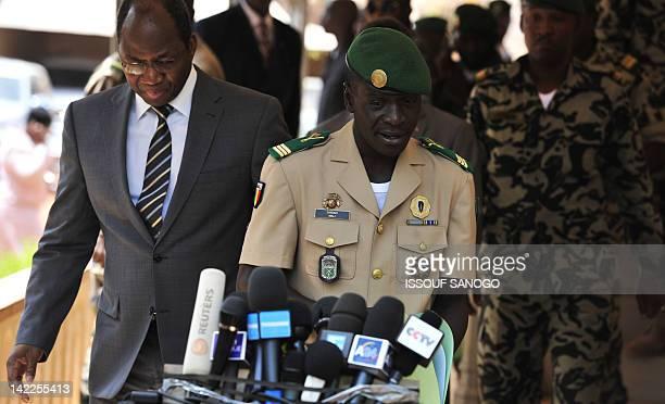 Malian junta leader Captain Amadou Sanogo and Burkina Faso's foreign Minister Djibrill Bassole arrive to make a declaration at the Kati military camp...