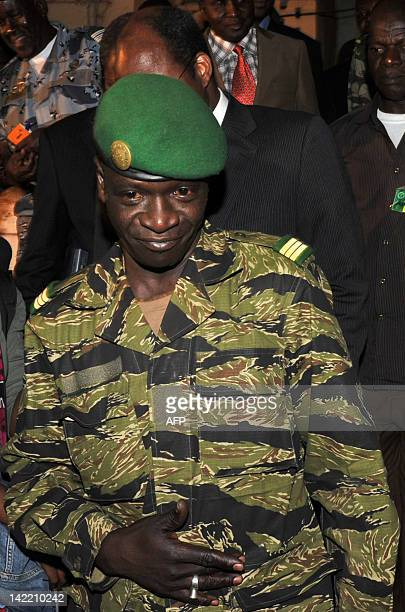 Malian junta leader captain Amadou Sanogo leaves his office after her meeting with Burkina Faso's Foreign Minister Djibril Bassole at the Kati...