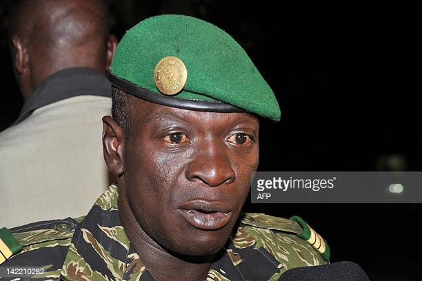Malian junta leader captain Amadou Sanogo speaks after his meeting with Burkina Faso's Foreign Minister Djibril Bassole at the Kati military camp...
