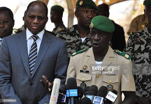 Malian junta leader captain Amadou Sanogo speaks next to Burkina Faso's Foreign Minister Djibrill Bassole during a declaration at the Kati military...