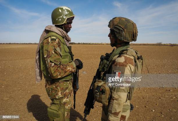 Malian Lieutenant Gouassou Diara speaks with French captain Gauthier on November 1 2017 in central Mali in the border zone with Burkina Faso and...